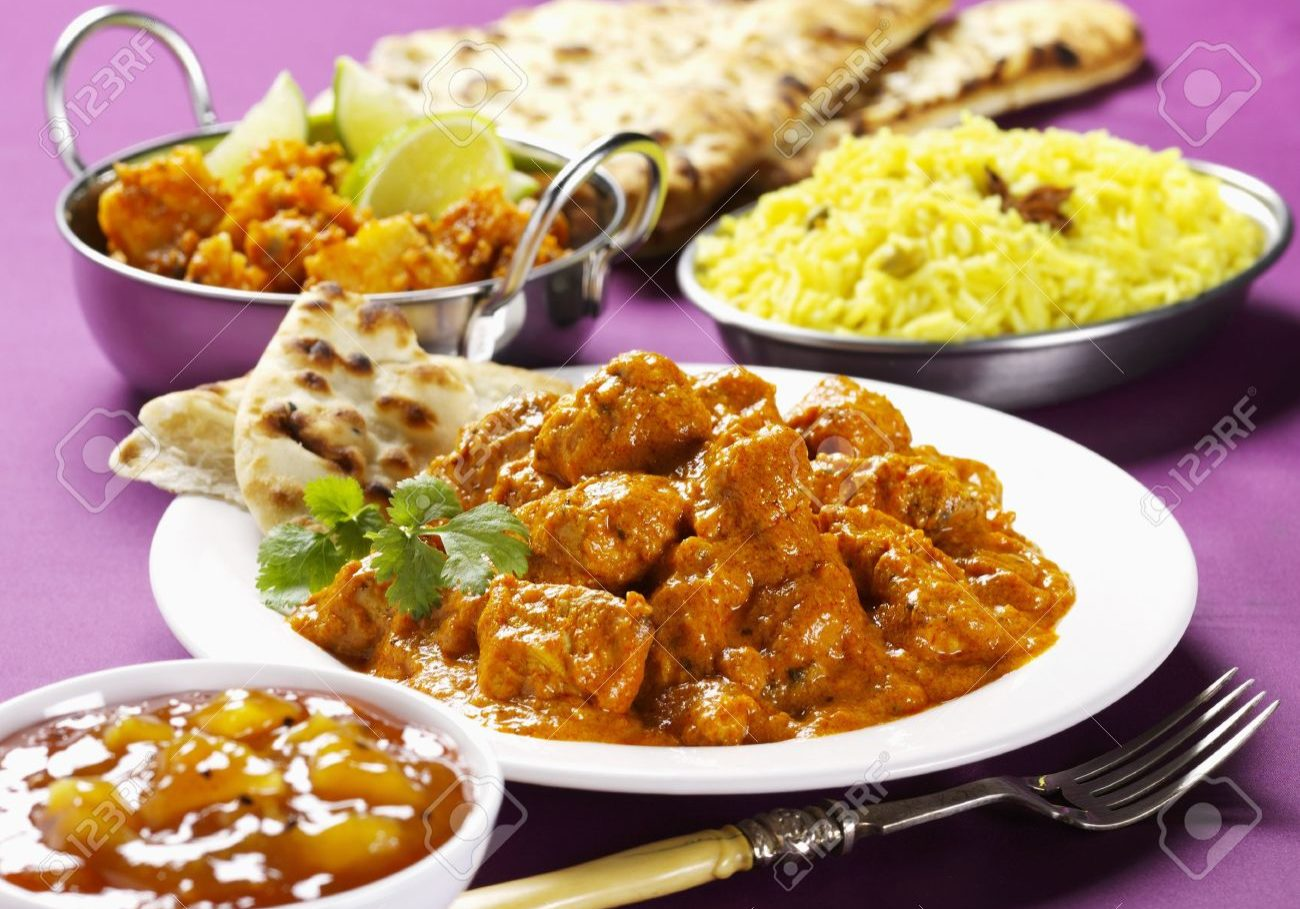 32833650-Chicken-tikka-masala-with-chutney-rice-and-naan-bread-India--Stock-Photo